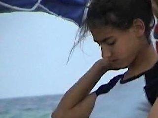 Latina Teen Changes Top On Beach